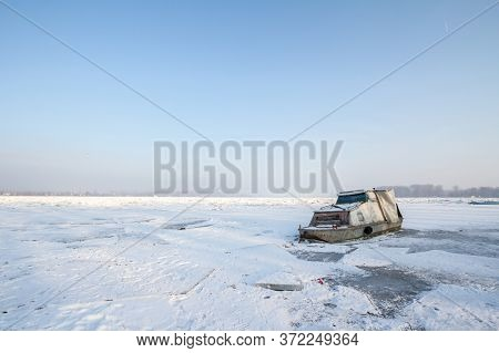 Boat Trapped On The Frozen Danube During The 2017 Winter, In Zemun, Belgrade, Serbia With Ice Poppin