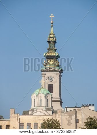 Saint Michael Cathedral, Also Known As Saborna Crkva, With Its Iconic Clocktower Seen From A Street