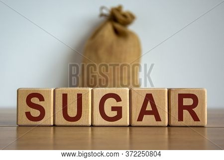 'sugar' Word On Wooden Cube Blocks With Canvas Bag On Background. Beautiful White Background, Copy S