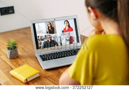 Virtual Conference, Online Meeting. Young Woman Uses Laptop App For Communicating With Several Peopl