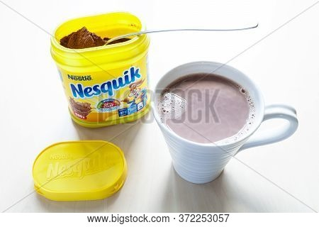 Moscow, Russia - June 16, 2020: Above View Of Open Jar Of Nesquik With Spoon And Mup With Cocoa On T