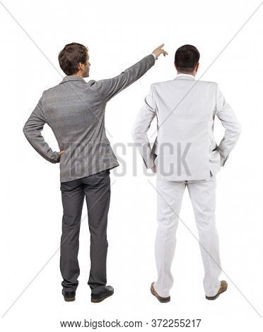 Back view of  two business men in suit pointing. Rear view people collection. backside view of person. Isolated over white background.