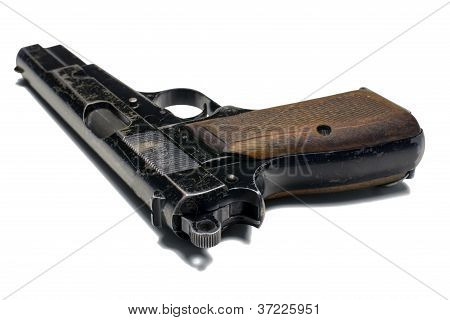 Old and worn 9 mm Pistol Close up On White Background