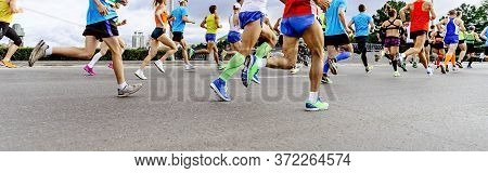 Group Runners Men And Women Run Marathon Race In City