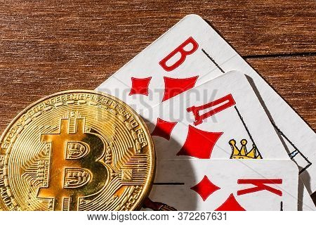 Bitcoin On Top Of Playing Cards. Online Gambling With Cryptocurrency.