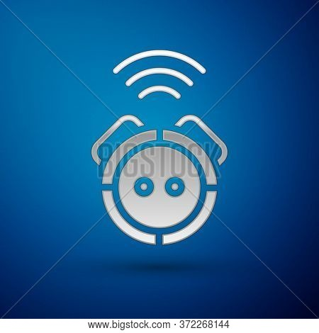 Silver Robot Vacuum Cleaner Icon Isolated On Blue Background. Home Smart Appliance For Automatic Vac