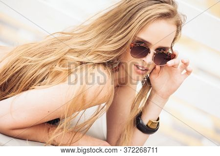 Summer Fashion. Girl Near Pool. Sexy Woman In Trendy Sunglasses And Fashionable Bikini Swimwear And