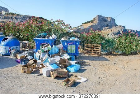 Lindos (island Of Rhodes), Greece - August 8 2019: Pile Of Rubbish Down On Ground Near Plastic Litte