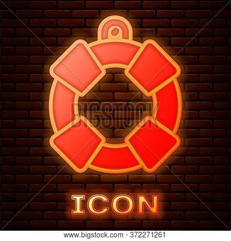 Glowing Neon Lifebuoy Icon Isolated On Brick Wall Background. Lifebelt Symbol. Vector