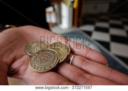 Nantou, Taiwan - December 18th, 2019: coins as a ticket at Nantou Cat Bank, Nantou, Taiwan, Asia