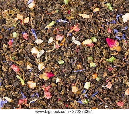 Tie Guan Yin Tea With Rose Buds, Candied Fruit, Cornflower Petals. Organic Tea Background. Top View.