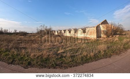 Abandoned Barn. The Ruins Of An Old Agricultural Barn.