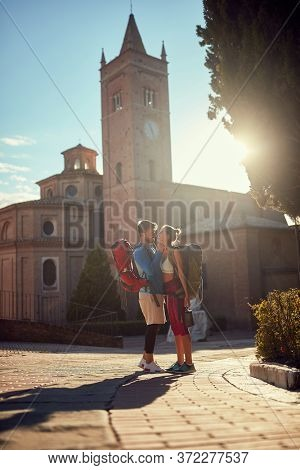 young adult couple is abut to kiss at sunset in italy, toskana