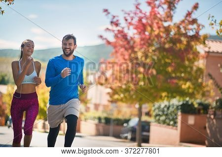 young caucasian spouses jogging outoor, italy, toscana, europe