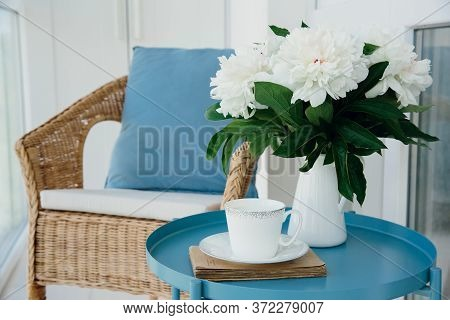 Summer Breakfast On Balcony. Bouquet Of White Peonies And Cup Of Drink On Blue Table. Interior. Flow