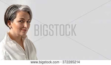 Caucasian Mid Adult Woman Smiles Slightly Looking At Camera Isolated On White Background. Close Up P