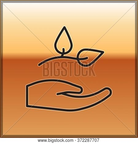 Black Line Leaf In Hand Of Environmental Protection Icon Isolated On Gold Background. Seed And Seedl