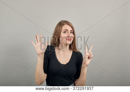 Showing 7 Fingers Hand Gesture, Show The Number Three With Hands, Pointing Up Arm While Smiling Conf