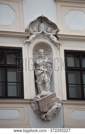 Architecture In Central Square In Vienna. Historical Statueon Wall Of Old Building In City Center. A