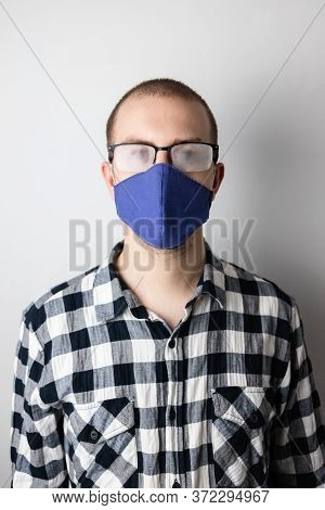 Man Wearing A Protective Mask And Fogged Glasses. New Habits During Covid-19 Pandemic. Hot Breath Fo