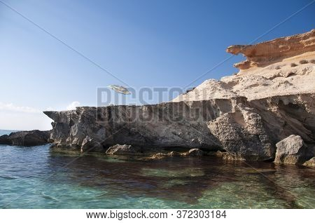 A Beach Umbrella On A Cliff Overlooking The Sea. Formentera Island, Mediterranean Sea, Spain