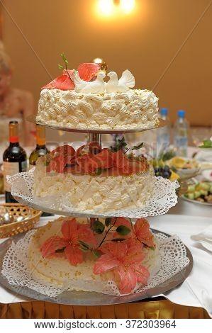 Three Tiered Wedding Cake With Pigeons Close Up