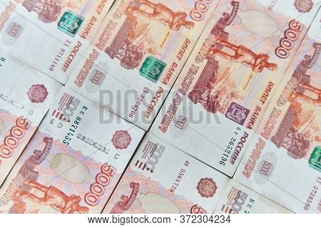 Money On Russia. Close-up Of Russian Rubles On Five Thousand And One Thousand Banknotes. Finance Con