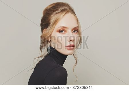 Perfect Woman With Updo Hair Wearing Black Turtleneck Sweater Portrait