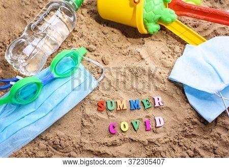 Beach Sand, Childrens Sand Toys, Face Masks. Summer Coronavirus. Covid-19. Stay Home