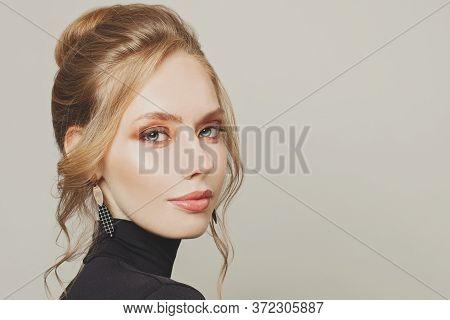 Glorious Blonde Woman With Hair Bun Hairdo Portrait