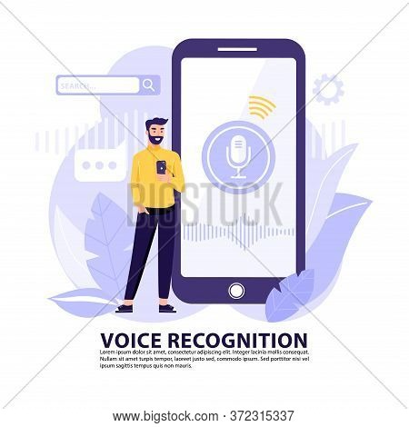 Voice Recognition Concept. Man With Big Smart Phone Using Voice Assistant Application. Intellectual
