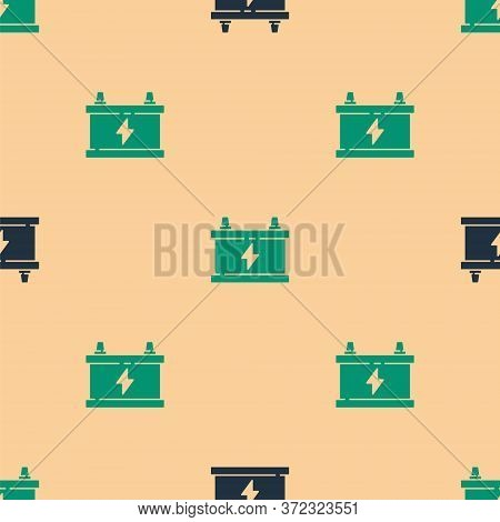 Green And Black Car Battery Icon Isolated Seamless Pattern On Beige Background. Accumulator Battery