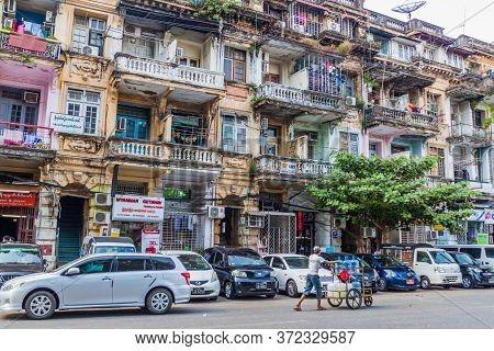 Yangon, Myanmar - December 15, 2016: Old Dilapidated Buildings In Yangon.