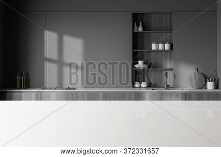 White Table For Your Product In Stylish Kitchen With Gray Walls, Dark Wooden Countertops With Built