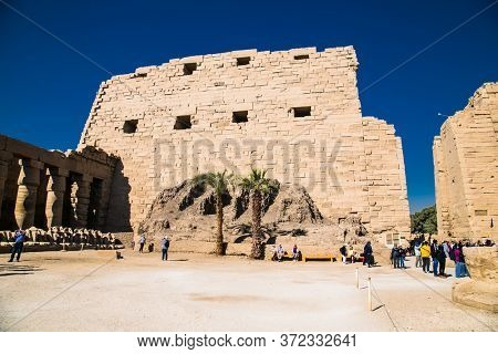 Luxor, Egypt - Jan 28, 2020: Ancient ruins of the Karnak Temple in Luxor (Thebes), Egypt. The largest temple complex of antiquity in the world. UNESCO World Heritage.