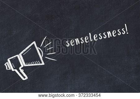 Black Chalkboard With Drawing Of A Loudspeaker And Inscription Senselessness