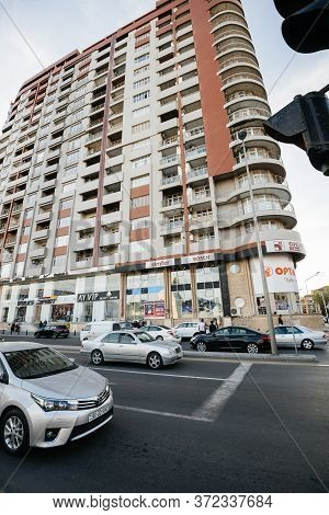 Baku, Azerbaijan - May 2, 2019: Low Angle View Of Tall Apartment Building In Central Baku With Lots
