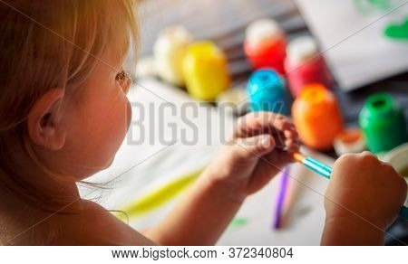 Cute Little Baby Having Fun at Home. Little Child Drawing With Colorful Paints in Daycare. Child's Creative Art And Activities. Happy Carefree Childhood.