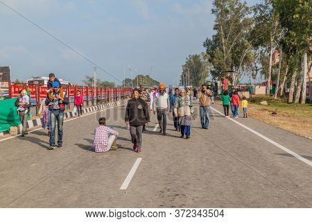 Wagah, India - January 26, 2017: People Walk To The Border To Watch The Military Ceremony At India-p