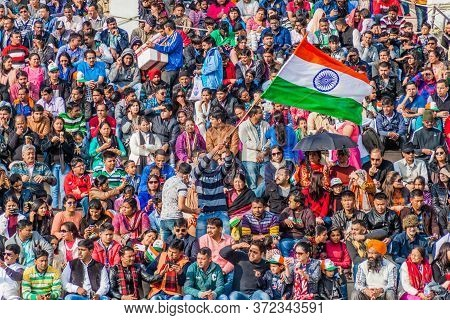 Wagah, India - January 26, 2017: Crowd Of Indian Spectators Watch The Military Ceremony At India-pak
