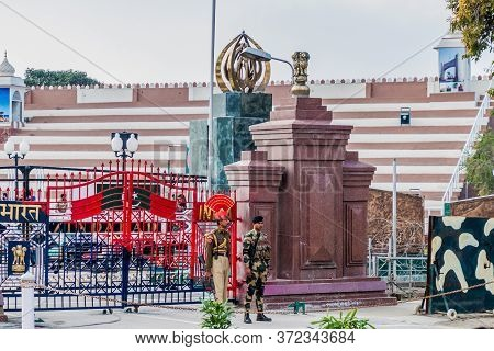 Wagah, India - January 26, 2017: Soldiers Guarding At India-pakistan Border In Wagah In Punjab, Indi