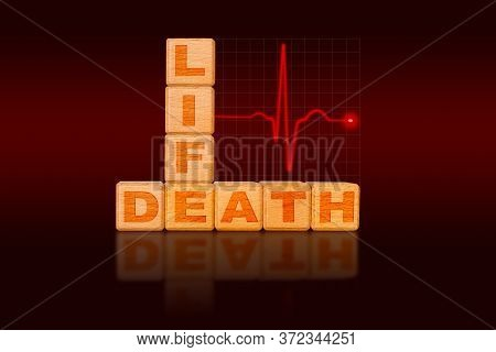 Life And Death Concept Written On Alphabet Blocks In The Form Of A Chart With Ecg Electrocardiogram