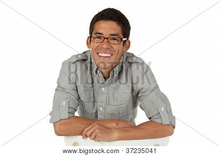 Man leaning on the back of a chair