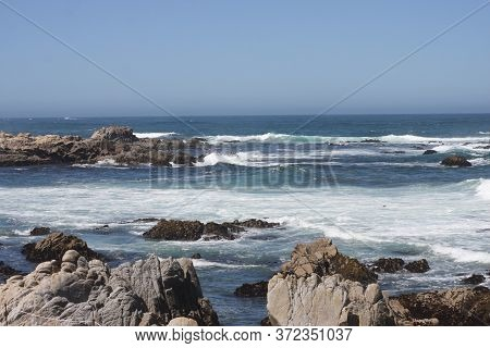 This Is An Image Of The Ocean Taken At Asilsomomar Beach In Pacific Grove, California.