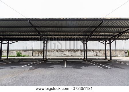 Car Park Empty Open Garage Roof.outdoor Of Parking Garage With Car And Vacant Parking Lot In Parking