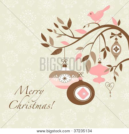 Christmas bird on a decorated branch