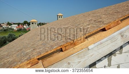 A Close-up On Roofing Construction, Roof Sheathing With Plywood Boards, Osb And Vapor, Damp-proof Me