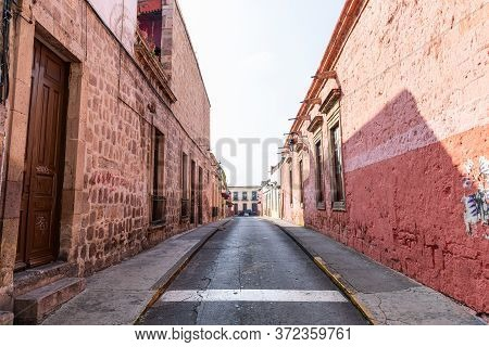 The View Of Old Buildings Down Fray Manuel Navarrete Street In Morelia, Michoacan, Mexico