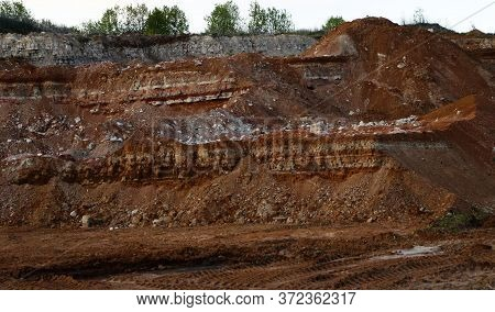 Textures Of Various Clay Layers Underground In Clay Quarry After Geological Study Of Soil. Colored L