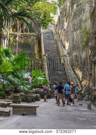 Nassau, Bahamas - May 3, 2019: Tourists Near The Queen's Staircase. The Queen's Staircase, Commonly